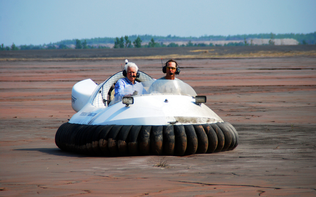 Neoteric commercial hovercraft utilized in dust suppression at iron ore mine in Hibbing, MN.
