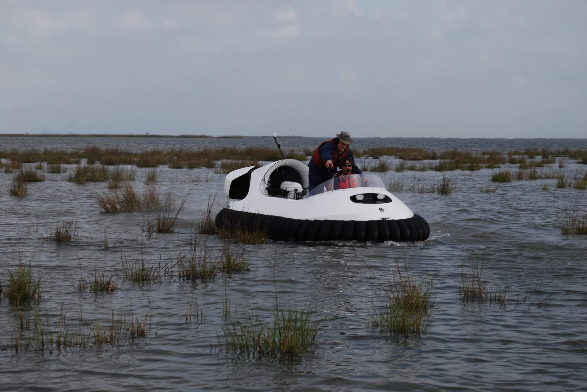 Neoteric Commercial Hovercraft training in tall grass marsh