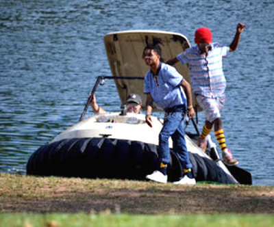 Image Rae Sremmard Khalif Swae Lee Brown photos Aaquil Slim Jimmy Brown Hip hop stars fly Neoteric Hovercraft golf cart MTV program