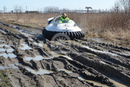 Photo Neoteric Hovercraft on mud in Russia