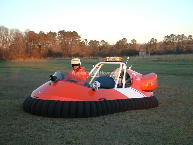 Dr. Miller Poses In His US Coast Guard Hovercraft Design